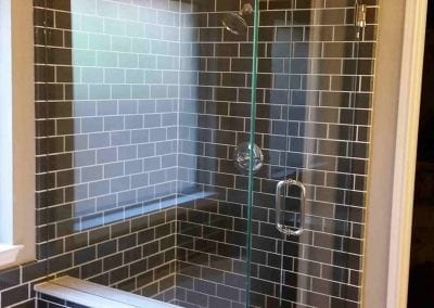 Frameless Shower Subway tile Chrome hardware Clear glass