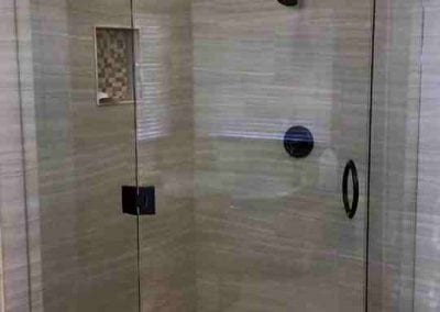 Frameless shower black hardware